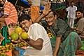 Selling oranges, Kolkata market