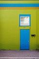Blue Door in Green Wall