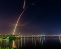 Time exposure of the Falcon 9 rocket and return of the first stage booster.