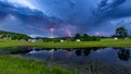 A lightning storm rolls past the coulee near sunrise on Memorial Day.