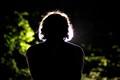 spotlight, behind singer