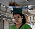 A sales lady taken on the circle line in Yangon, Myanmar.