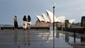 Tourists admiring Sydney Opera House in Sydney.