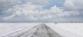 Snow covered country road