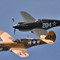 Warhawk pair.Curtiss P40 F Warhawk in front and P40B behnd. the latter is rebuilt survivor of the Pearl Harbour attack.