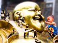 Laughing Buddha and happy boy