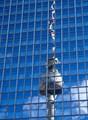 The steel Fernsehturm reflected in the glass facade of the Park Inn by Radisson at Alexanderplatz, Berlin