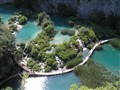 Shiny rays of the sun reflected in crystal clear water of National Park Plitvice, Croatia.