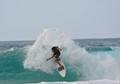 At Pipeline on Oahu a surfer does a beautiful thing