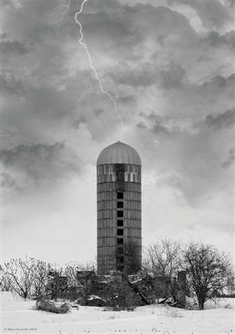 Silo in a winter storm with lightning