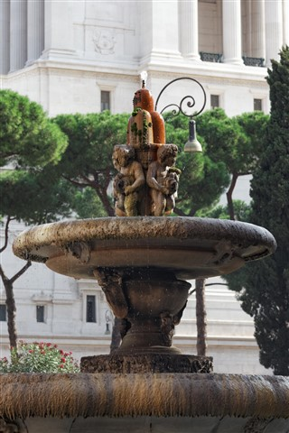 А charming fountain in the center of Rome