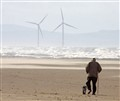Windy walk on a cold English beach