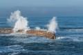 Wild ocean causes huge waves to hit seawall