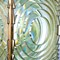 large fresnel lens of lighthouse beacon as abstract background