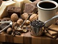 still life of chocolate and coffee and nuts.