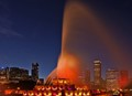 This is an image of the venerable Buckingham Fountain in Chicago, IL. Every hour the large spout of water commences and in the evening it is beautifully lit.