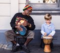 Street player and child.
