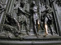 shiny leg on the main portal of Milano's Duomo