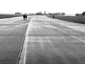 There is a meditative quality to walking on the runways of Tempelhof airport, closed by Berlin authorities in 2008. The vastness and fresh air makes every step a little lighter and the mind does tend to fly freely.