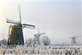 Windmills in a frosty and misty world