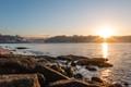 Sunrise shining on the rocks with the Arrábida bridge on the background.