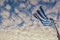 Greek flag of a ferry boat in Aegean Sea.