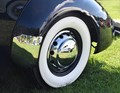 1947 Packard Sedan, reflected in the hubcap, fender and body of a 1937 Cord Phaeton Convertible.  Taken at Hemmings 2018 Concours d'Elegance, Lake George, NY, USA