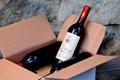 unpacking a box of wine bottles