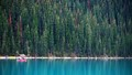 Canoeing on the frigid and naturally pale blue Lake Louise.