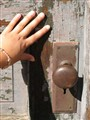 Young Hand and Rusted Hardware