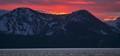 Sun behind the mountains of Lake Tahoe