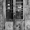 Door in Naples: A door in Naples.  Photo taken in late '70s, Ilford HP4 135 film, Yashica TL Electro X, Yashinon DX 50 1,7. Scan with very basic scanner.