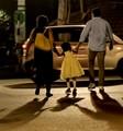 Happy family ,with a gay child,crossing Street,Kolkata,India.