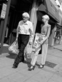A grab shot of this elegant looking couple doing a spot of shopping in Wimbledon. This lady is definately growing old with style!