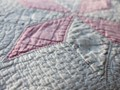 Sixty year old hand-stitched quilt.