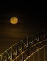 rising over the Sydney Harbour Bridge
