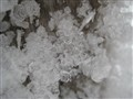 Ice crystals on a wooden pole