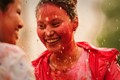 Friends rain-dancing and enjoying Holi - the festival of colors,